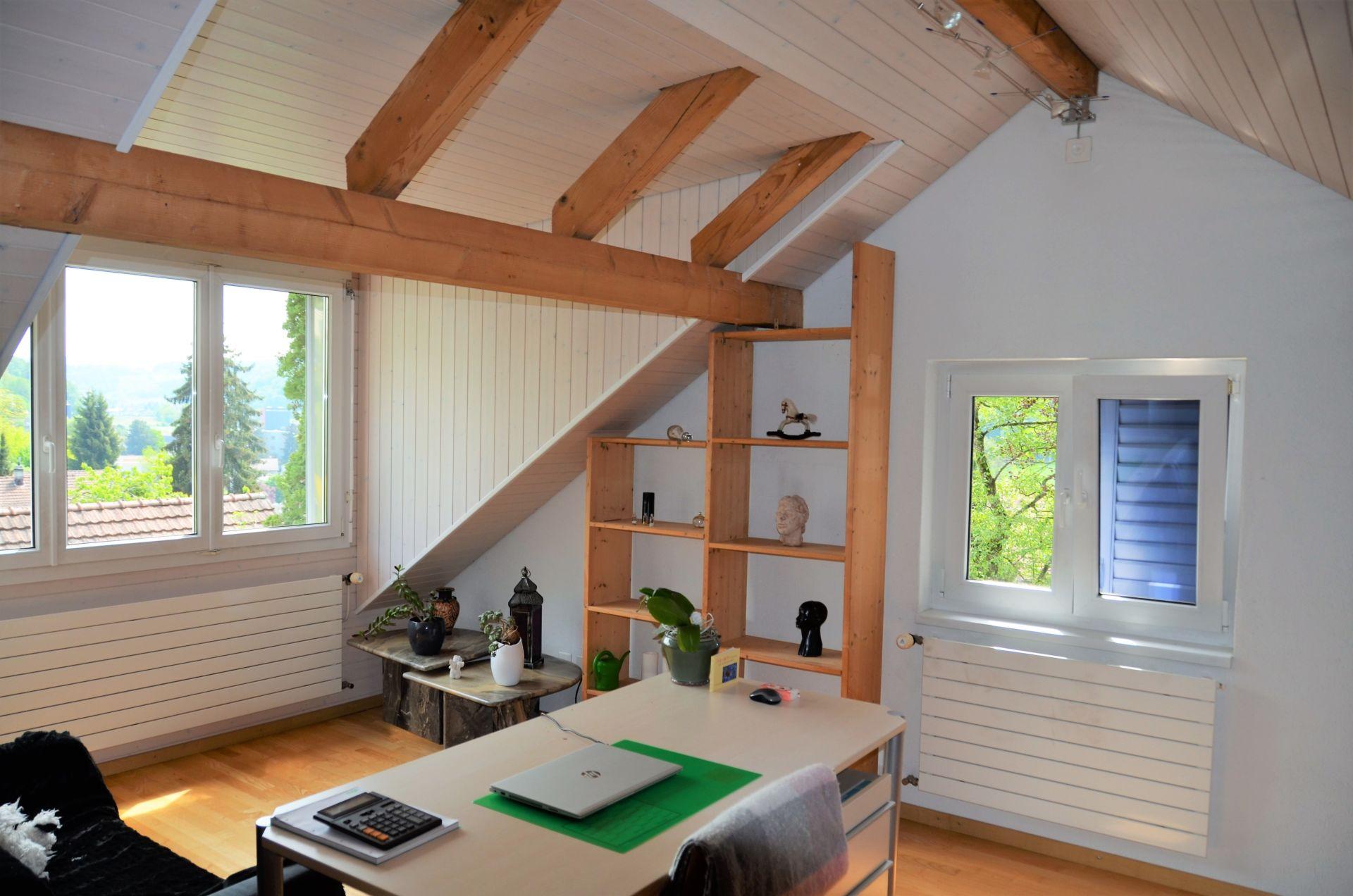 ausgebautes Dachgeschoss mit Lukarne